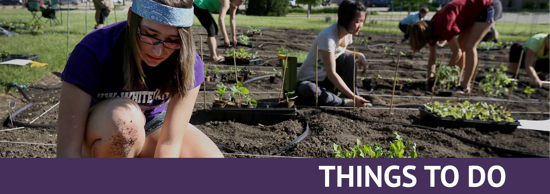 Community Resources: Students planting in a garden