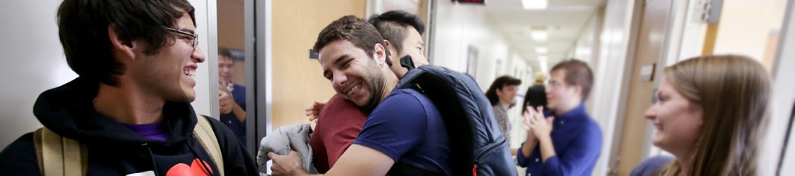English Language Academy students hug