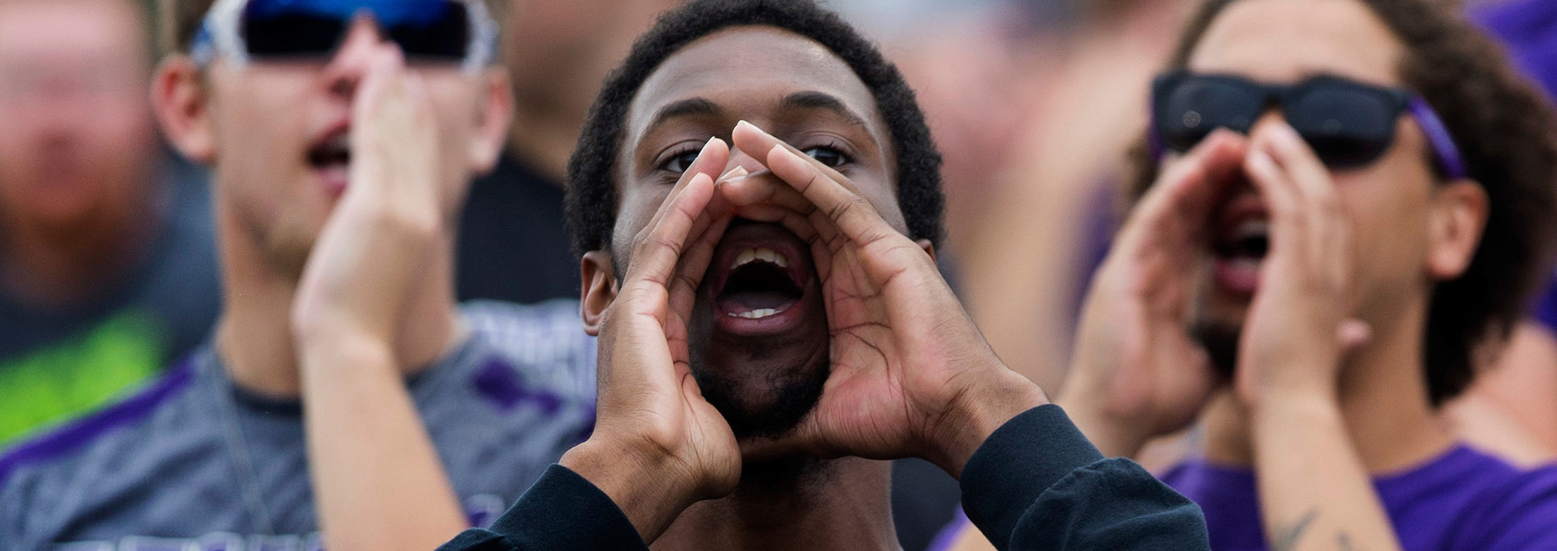 International student cheering at UW-Whitewater football game