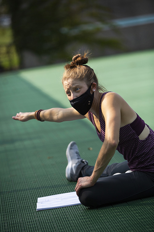 Piper Morgan Hayes stretches on the tennis courts.
