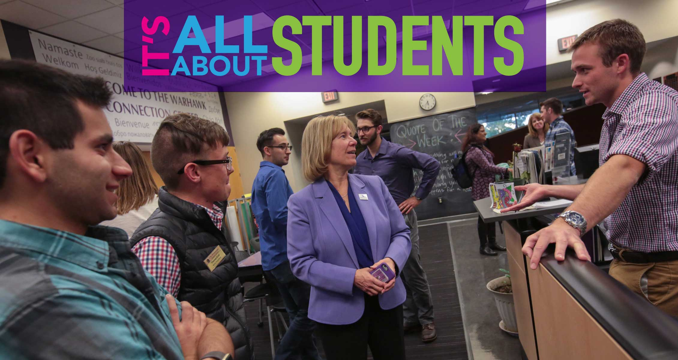 It's All About Students: Campus leader surrounded by and listening to students