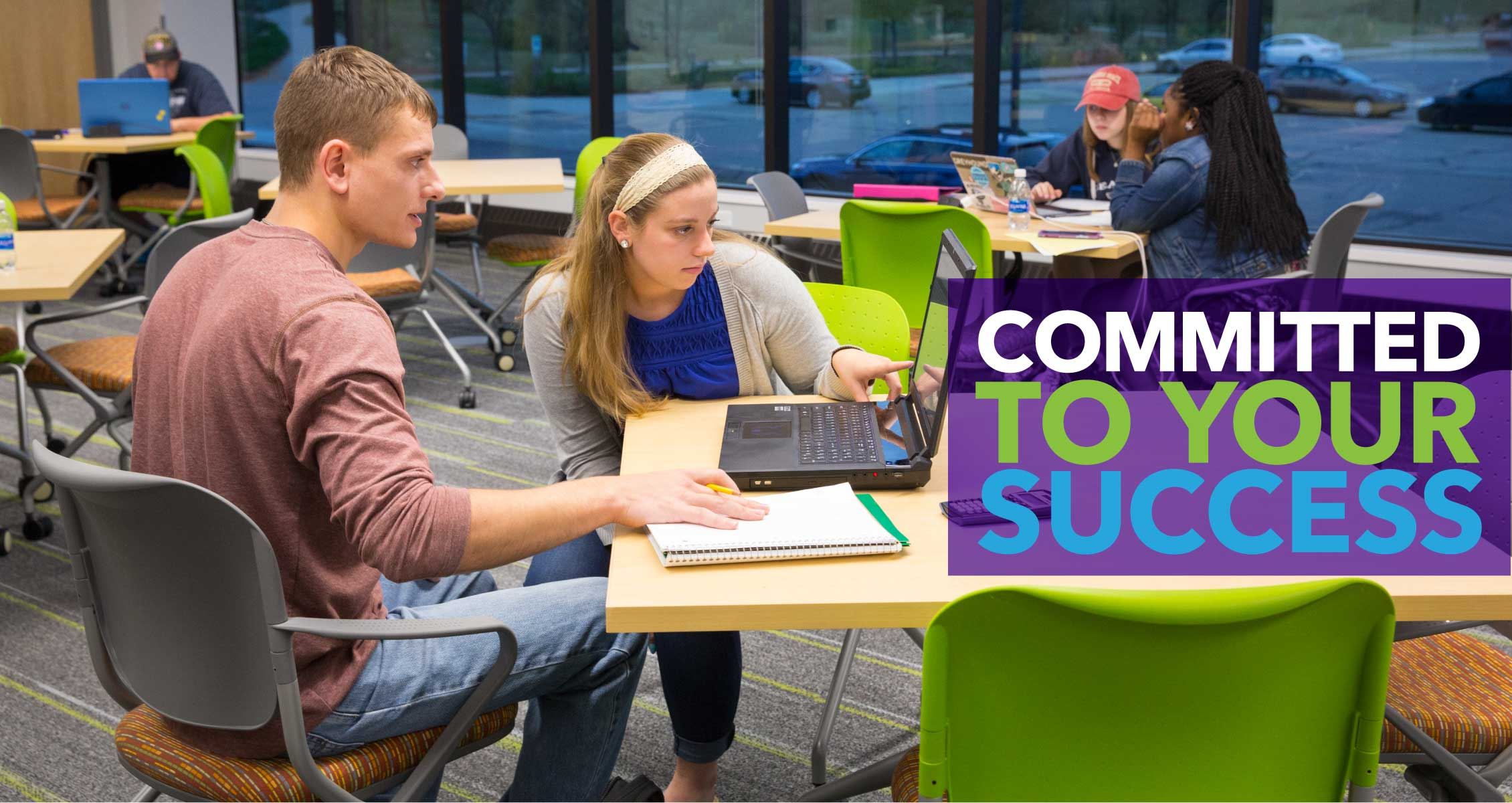 Committed to Your Success: Students studying together in a bright, open room