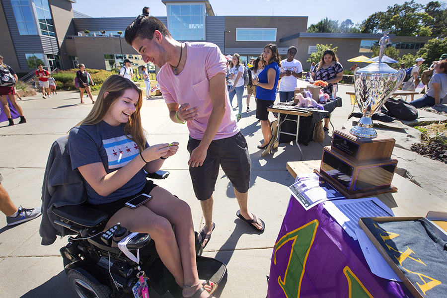 Two students share a smile on the mall of the UW-Whitewater campus.