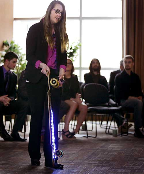 Kristen Holtan demonstrates a longboard with LED lights.