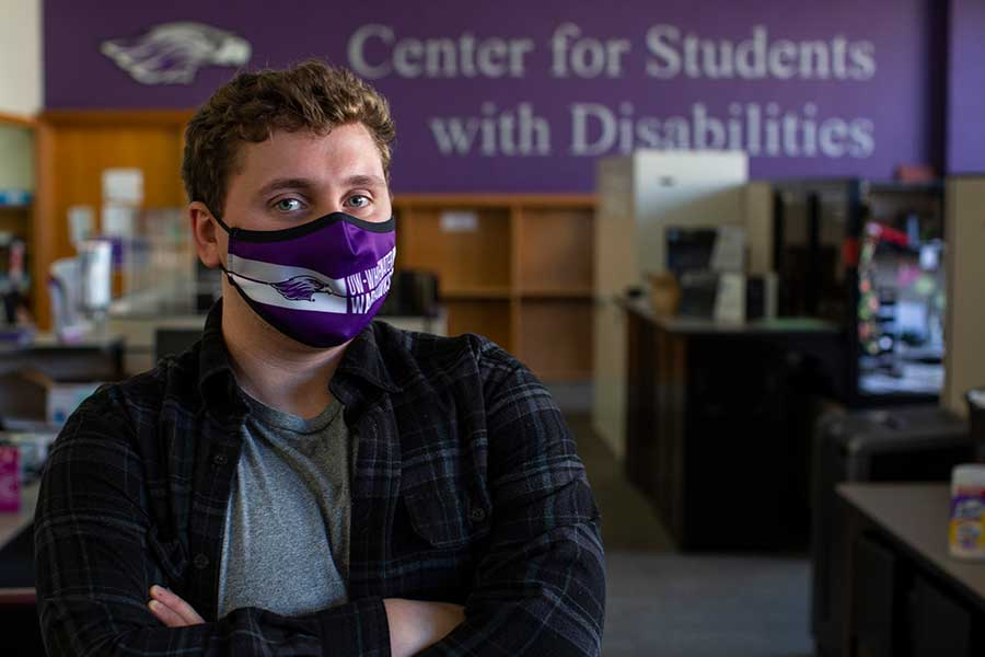 Thomas Hamilton stands in the office of the Center for Students with Disabilities.