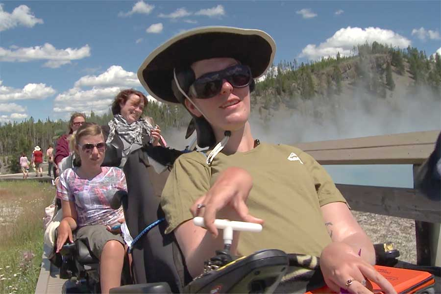 Student in wheelchair on a trail in Yellowstone National Park.