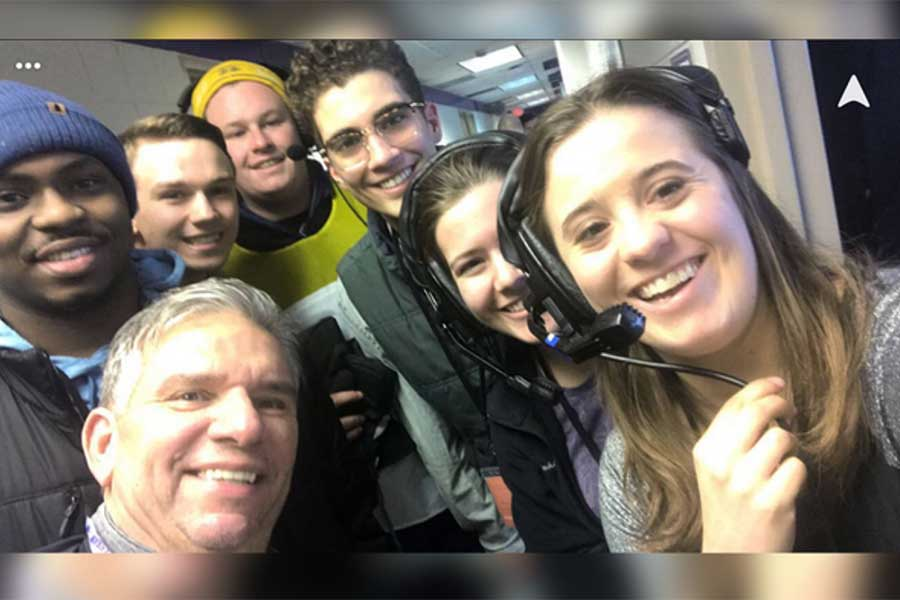 Annmarie Lavorata with other students in a broadcast booth.