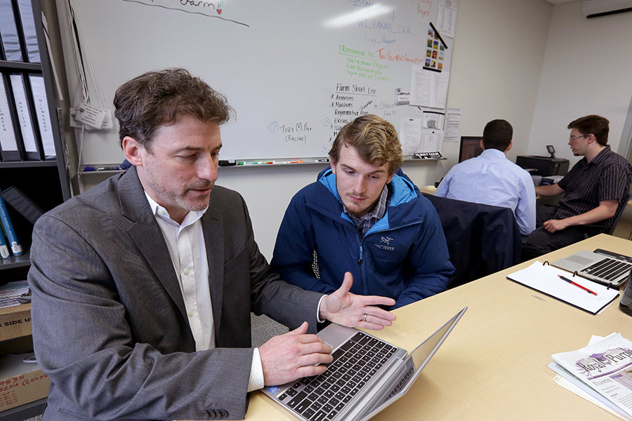 James Levy works with a student in Laurentide Hall.