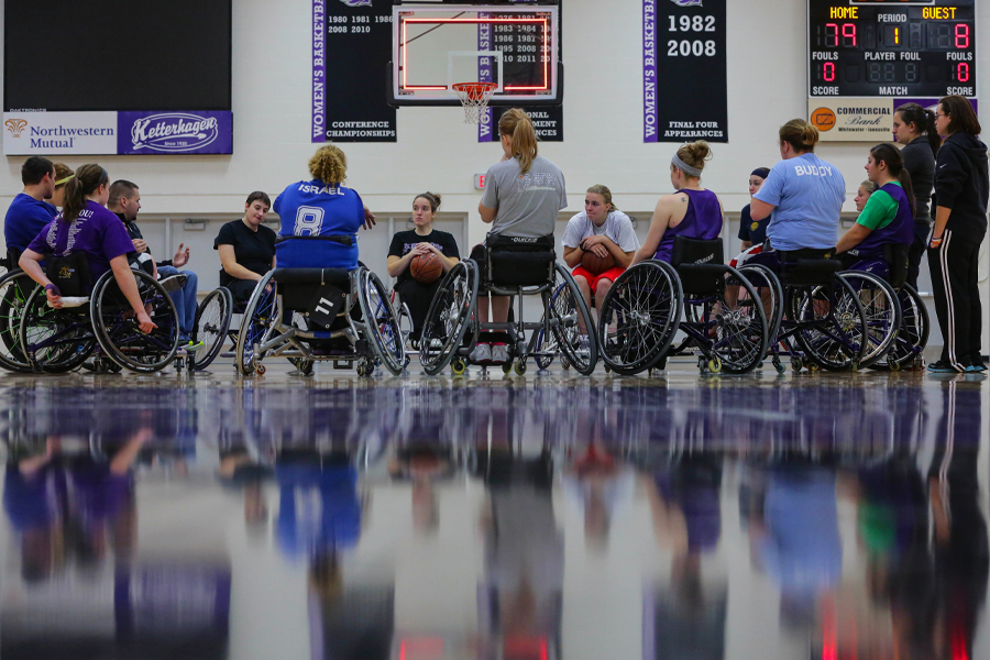 Wheelchair basketball players on the court.