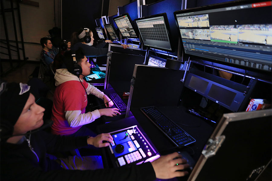 Students work with several monitors to broadcast a basketball game at UW-Whitewater.