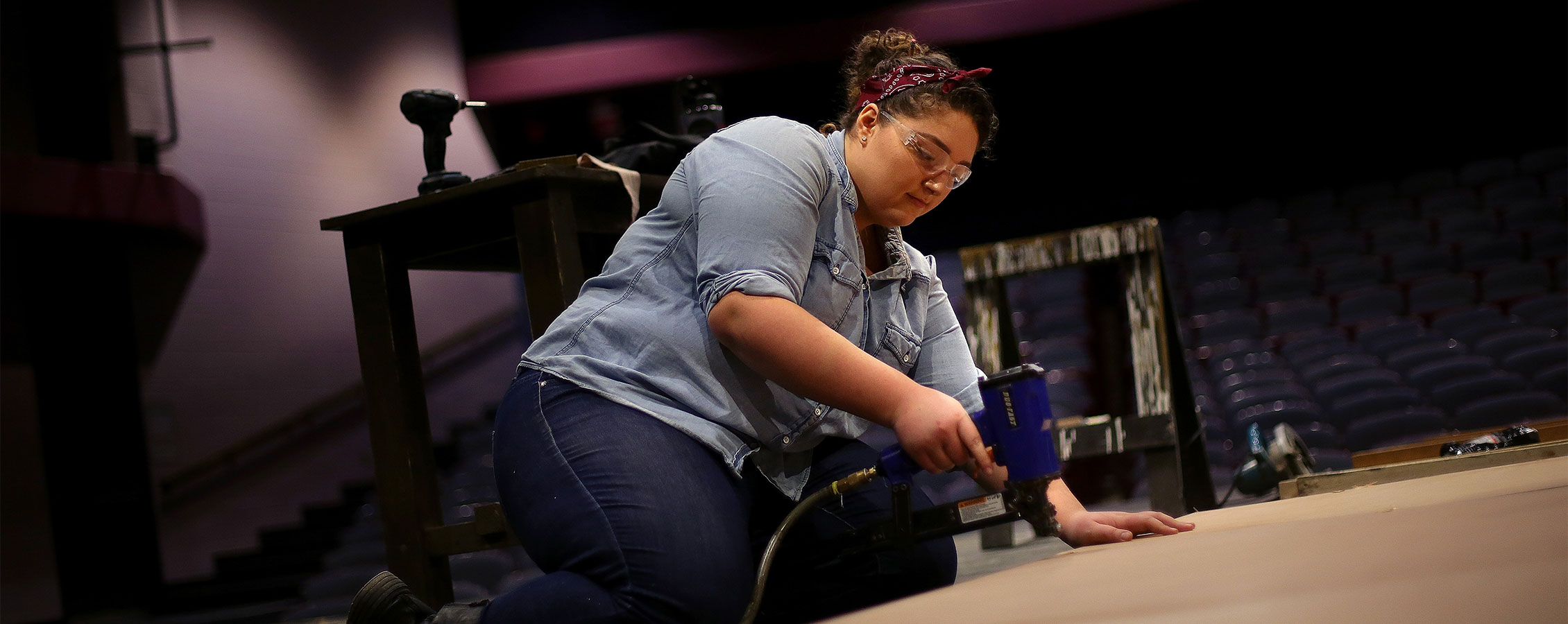 Theatre major creates a set for a play on the University of Wisconsin Whitewater campus.