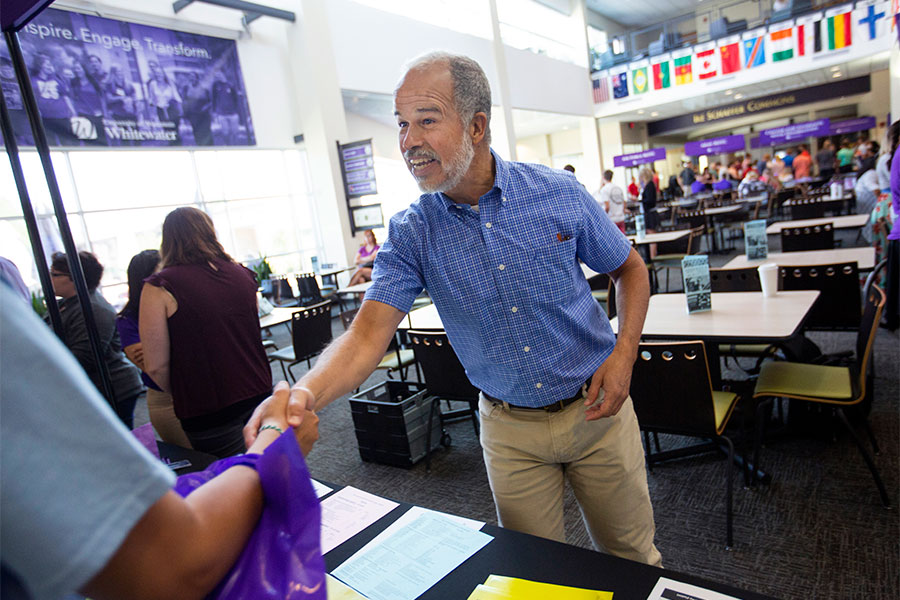 Shaking hands in the University Center on the UW-Whitewater campus.