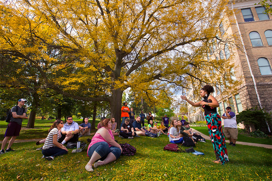 students enjoy an outdoor class at UW-Whitewater on an autumn day.