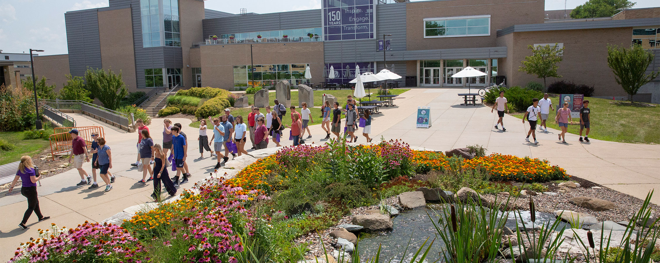 Potential Warhawks and their families take a tour on the UW-Whitewater campus.