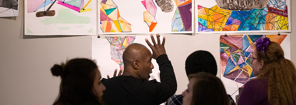 Visiting Artist Nick Cave provides feedback for student art.