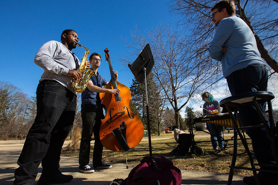 Brad Townsend instructs a jazz combo during an outside lesson UW-Whitewater/Craig Schreiner