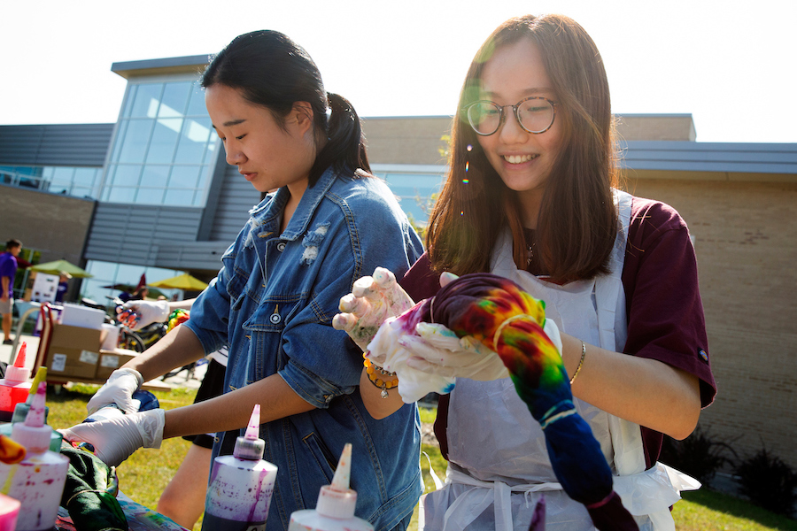 Students tie-dye shirts outside of the University Center at UW-Whitewater.
