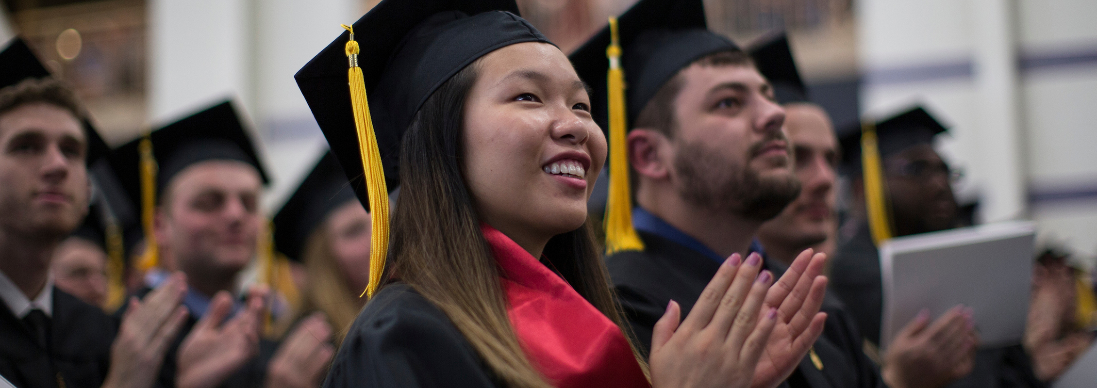 International student applanuding at UW-Whitewater graduation
