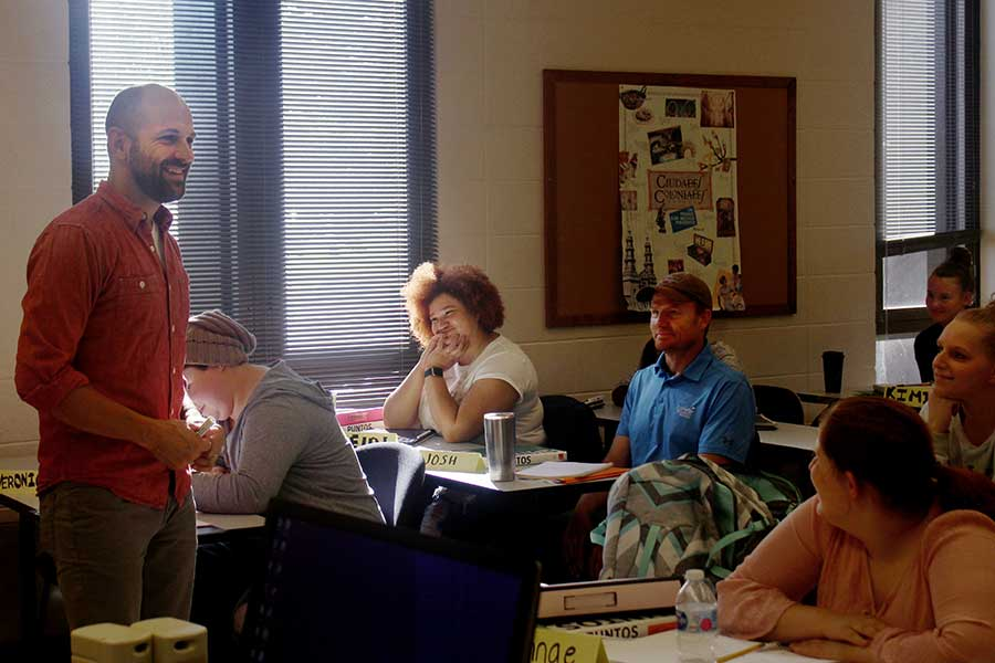 Nate Maddux teaches in a class full of students.