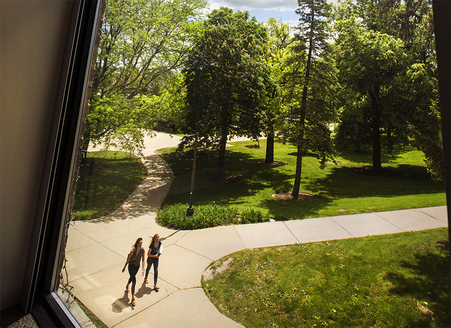 A window from a classroom at Hyer Hall looks out on Chopp Arboretum on campus.